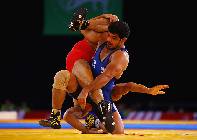 Sushil Kumar of India (blue) on his way to beating Qamar Abbas of Pakistan in the 74kg Freestyle Wrestling Gold medal match during the Glasgow 2014 Commonwealth Games on July 29