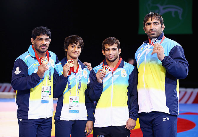 Indian medalists Sushil Kumar (gold 74kg) Vinesh (gold 48kg) Amit Amit Kumar (gold 57kg) and Rajeev Tomar (silver 125kg) pose with their medals after the Freestyle Wrestling finals at Scottish Exhibition And Conference Centre during the Glasgow 2014 Commonwealth Games on July 29