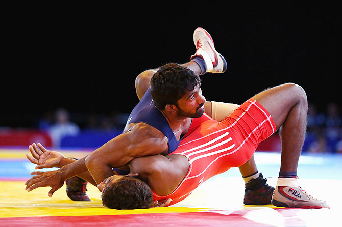 Yogeshwar Dutt of India defeats Chamara Perera of Sri Lanka in the semi-final of the 65kg Men's Wrestling at the Glasgow 2014 Commonwealth Games on July 31