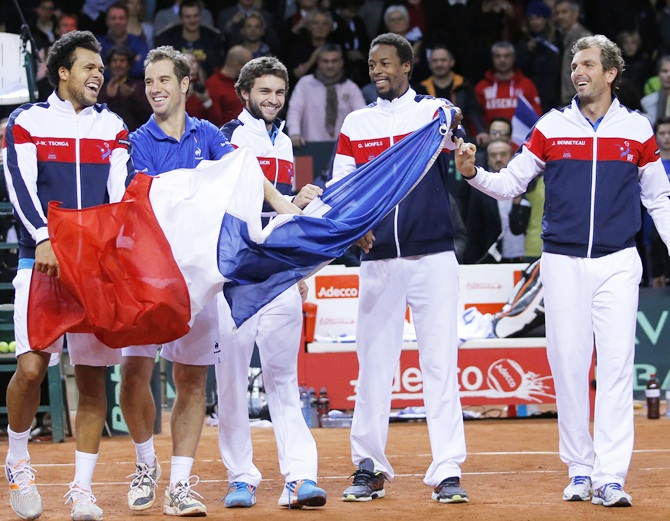French team players (from left) Jo-Wilfried Tsonga, Richard Gasquet, Gilles Simon, Gael Monfils and Julien Benneteau celebrate