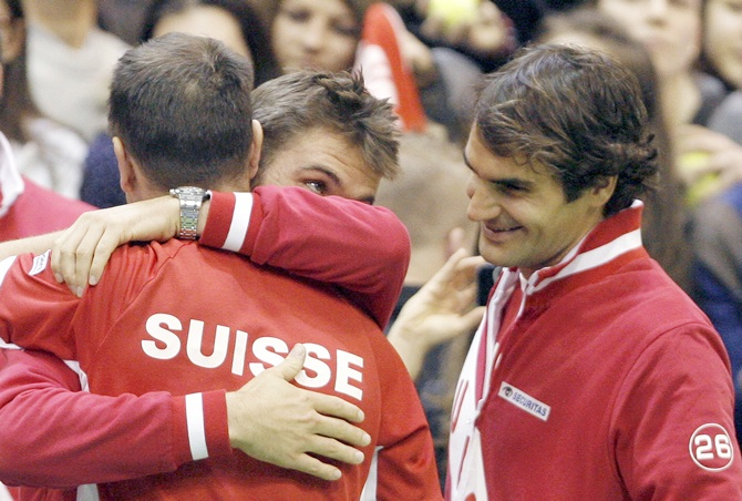 Switzerland's team captain Severin Luthi, Stanislas Wawrinka and Roger Federer