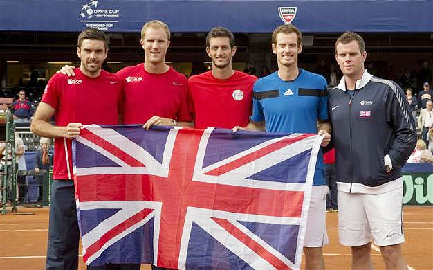 Colin Fleming, Dominic Inglot, James Ward, Andy Murray and Captain Leon Smith (GBR) pose with the British flag after defeating the USA in their Davis Cup tie at Petco Park in San Diego on Sunday