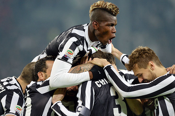 Juventus players celebrate a goal against Inter Milan on Sunday