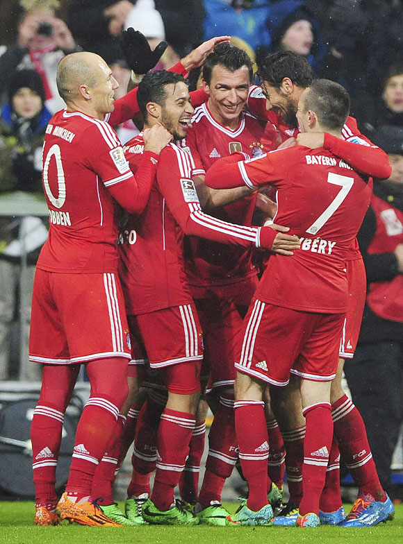Bayern Munich's players celebrate a goal against Eintracht Frankfurt during their Bundesliga match in Munich on Sunday