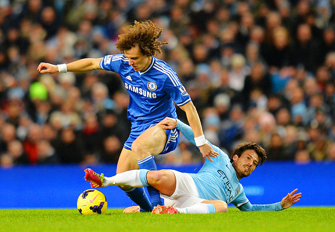 David Silva of Manchester City and David Luiz of Chelsea battle for the ball during their match on Monday
