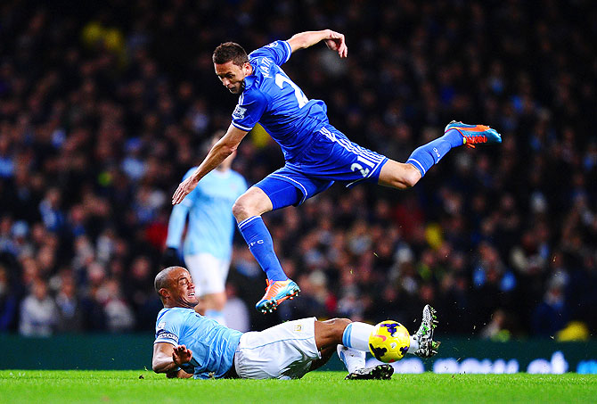 Vincent Kompany of Manchester City tackles Nemanja Matic of Chelsea on Monday