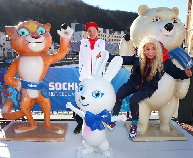 Aimee Fuller and Jamie Nicholls of the Great Britain Snowboard Team joke around on the official mascots