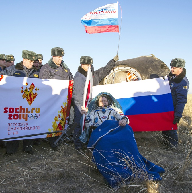 International Space Station (ISS) crew member Russian cosmonaut Fyodor   Yurchikhin holds the torch of the 2014 Sochi Winter   Olympic Games after landing near the town of Zhezkazgan in central Kazakhstan