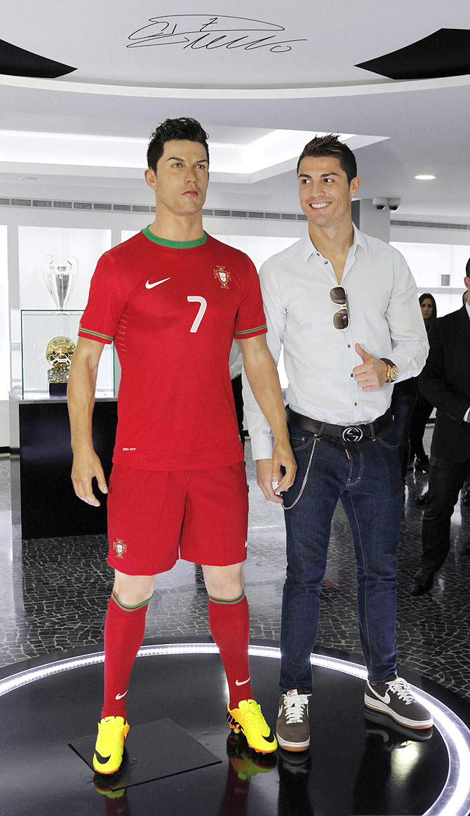 Real Madrid and Portugal's Cristiano Ronaldo, poses with his statue during the inauguration of his CR7 museum in his birthplace Funchal in Portugal on Sunday. Ronaldo opened a museum in his honour
