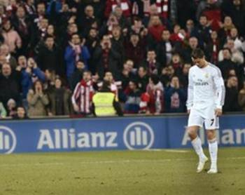 Real Madrid's Cristiano Ronaldo reacts after receiving a red card during their Spanish first division soccer match against Athletic Bilbao at San Mames stadium in Bilbao February 2