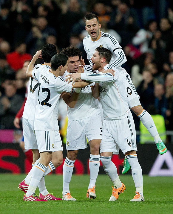 Pepe of Real Madrid celebrates scoring their opening goal with teammates during the Copa del Rey semi-final first leg match against Atletico Madrid at Estadio Santiago Bernabeu in Madrid on Wednesday