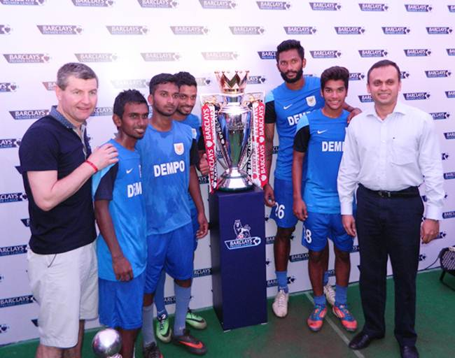 Denis Irwin (left), Shrinivas Dempo (extreme right) and Dempo SC players with the  Barclay's Premier League trophy
