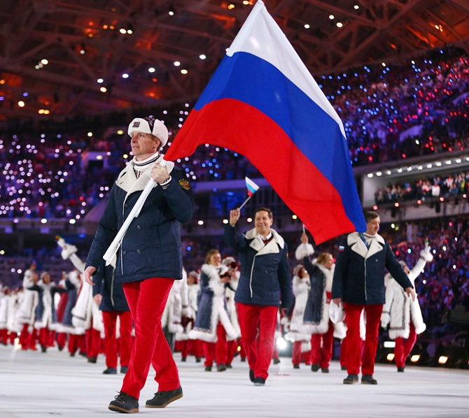 Bobsleigh racer Alexander Zubkov of the Russia Olympic team carries his country's flag during the Opening Ceremony.