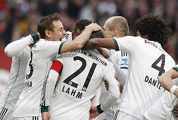 Bayern Munich's team celebrates Philipp Lahm's goal during their Bundesliga match on Saturday