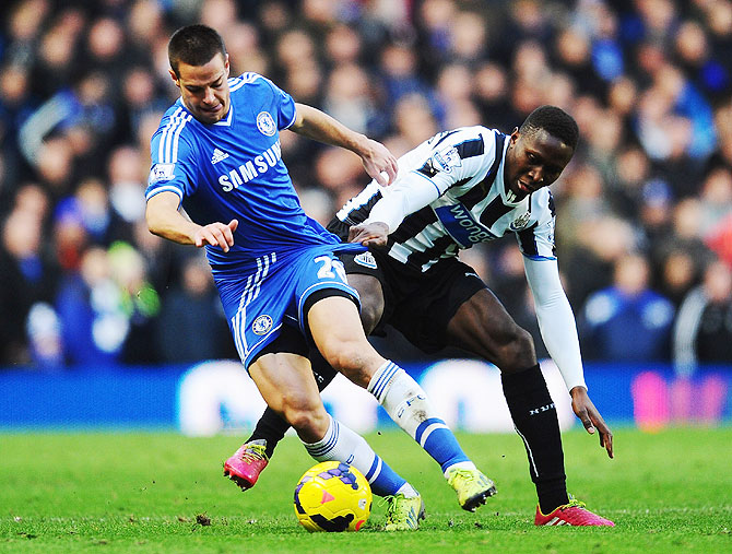 Cesar Azpilicueta of Chelsea holds off Mapou Yanga-Mbiwa of Newcastle United during their match at Stamford Bridge on Saturday