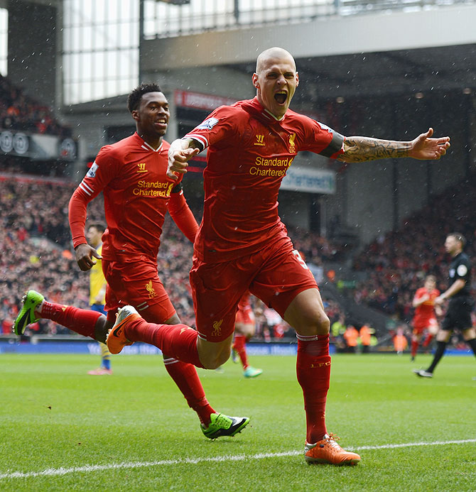 Martin Skrtel of Liverpool celebrates scoring the opening goal against Arsenal on Saturday