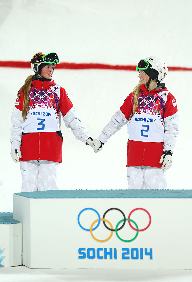Silver medalist Chloe Dufour-Lapointe of Canada and gold medalist Justine Dufour-Lapointe of Canada congratulate each other during the flower ceremony following the Ladies' Moguls Final at Rosa Khutor Extreme Park in Sochi on Saturday