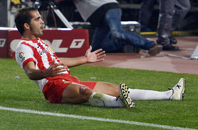 Almeria's Jose Antonio Garcia Verza celebrates after scoring against Atletico Madrid during their La Liga mat