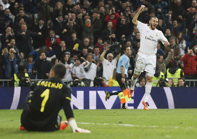 Real Madrid's Karim Benzema celebrates after scoring his second goal against Villarreal at Santiago Bernabeu stadium in Madrid on Saturday