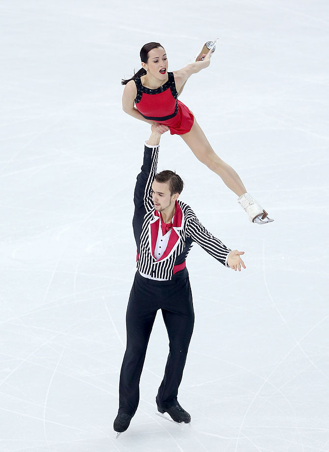 Ksenia Stolbova and Fedor Klimov of Russia compete in the Figure Skating Team Pairs Free Skating at Iceberg Skating Palace in Sochi on Saturday