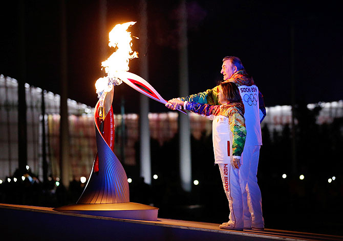 Irina Rodnina and Vladislav Tretyak light the Olympic cauldron during the opening ceremony of the 2014 Winter Olympics in Sochi on Friday