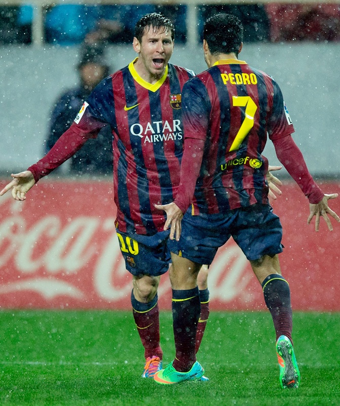 Lionel Messi of FC Barcelona celebrates scoring their second goal.