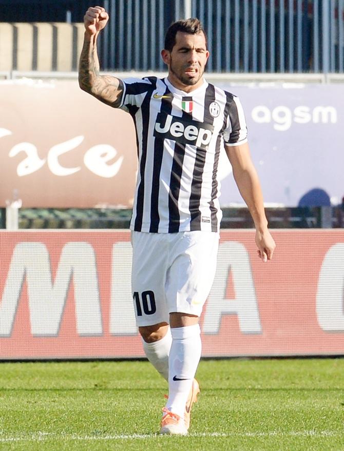 Carlos Tevez of Juventus celebrates after scoring his opening goal.