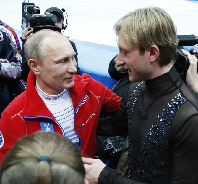 Russian President Vladimir Putin, left, greets Yevgeny Plushenko.
