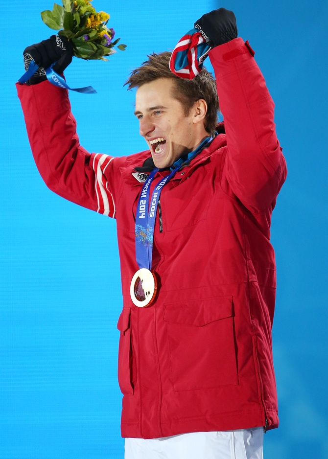 Gold medalist Matthias Mayer of Austria celebrates during the medal ceremony.