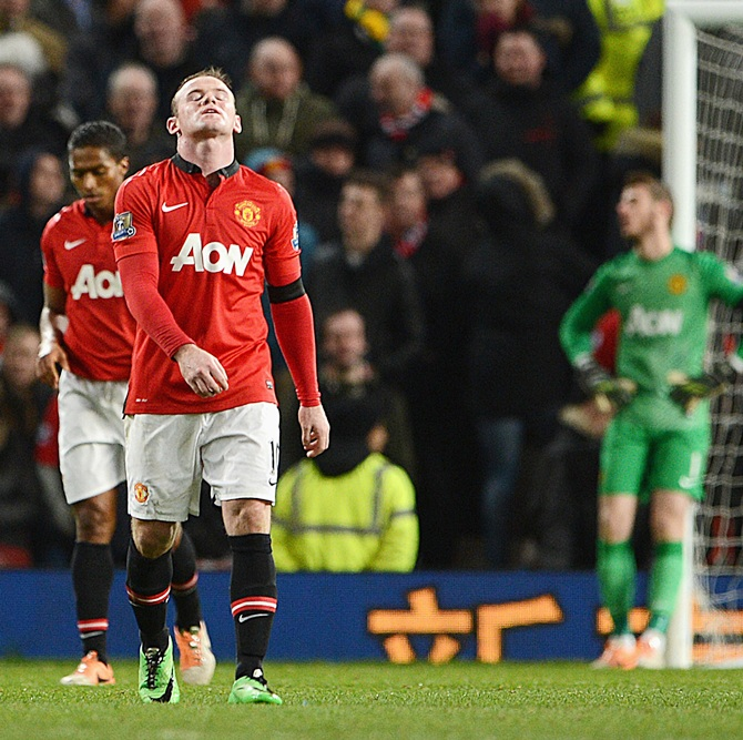 Wayne Rooney of Manchester United reacts after Fulham's second goal.