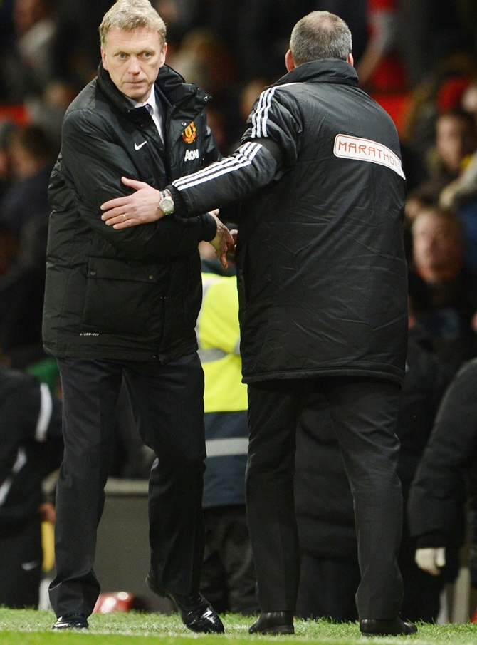 Fulham Manager Rene Meulensteen shakes hands with David Moyes of Manchester United.
