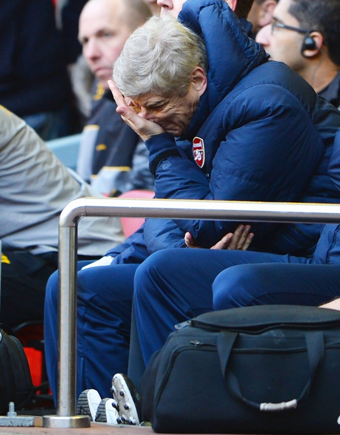 Arsenal Manager Arsene Wenger looks dejected.