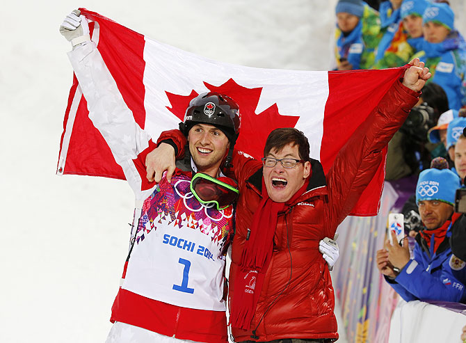 Canada's Alex Bilodeau and his brother Frederic celebrate following the freestyle skiing moguls competition at the 2014 Sochi Winter Olympic Games in Rosa Khutor on Monday