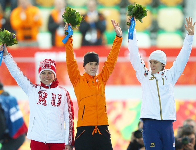 Silver medalist Martina Sablikova of the Czech Republic,right, gold medalist Irene Wust of the   Netherlands, centre, and bronze medalist Olga Graf of Russia celebrate on the podium.
