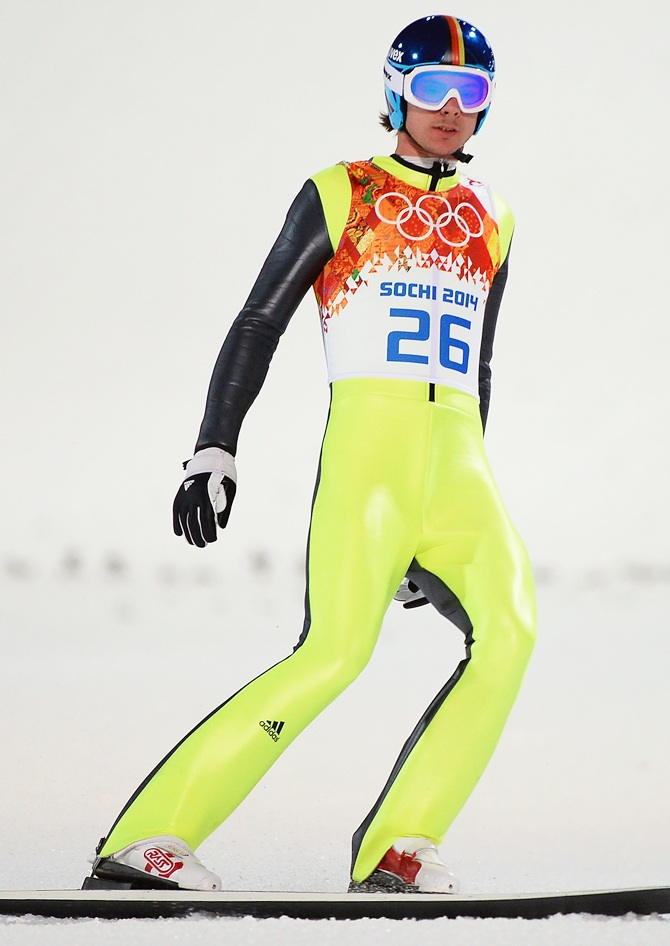 Andreas Wank of Germany lands his jump during the Men's Normal Hill Individual.