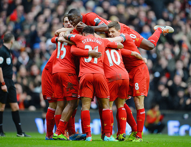 Daniel Sturridge of Liverpool celebrates with his team-mates after scoring against Arsenal Saturday.