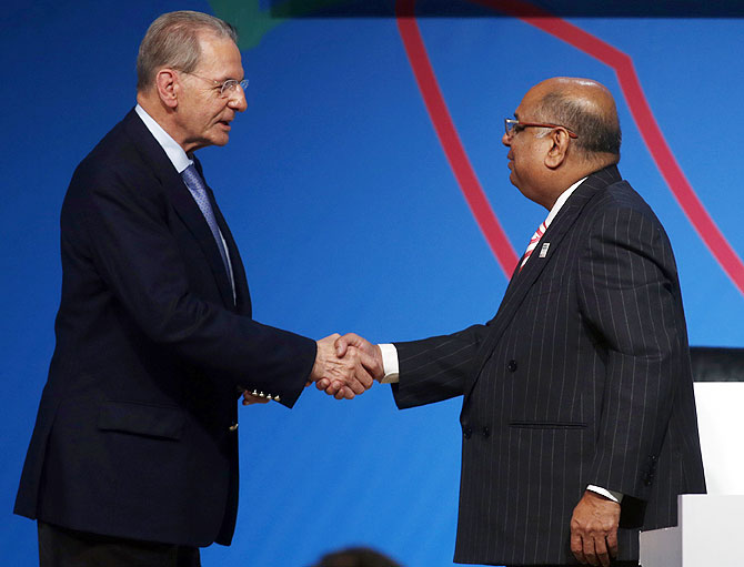 Former International Olympic Committee president Jacques Rogge (left) greets Narayana Ramachandran on September 8, 2013