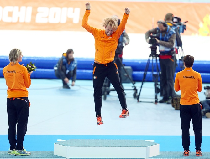 (From Left) Bronze medalist Ronald Mulder of the Netherlands, gold medallist Michel Mulder of the Netherlands and Silver medalist Jan Smeekens of the Netherlands celebrate on the podium.