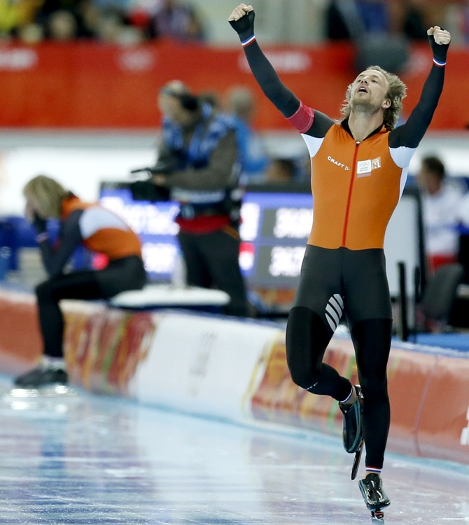 Michel Mulder of the Netherlands celebrates winning the men's 500 meters speed skating.