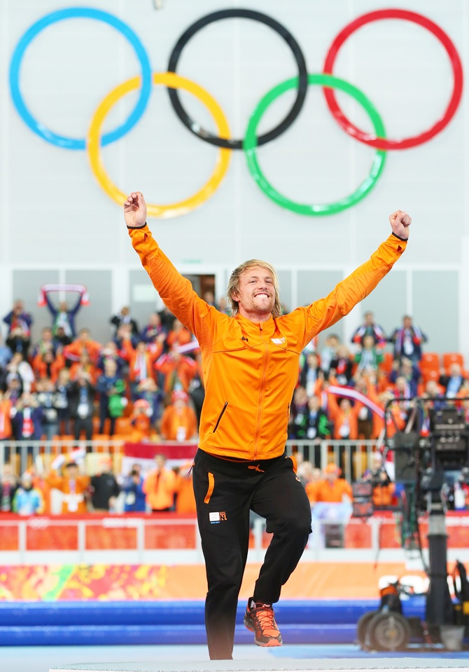 Gold medalist Michel Mulder of the Netherlands celebrates on the podium.