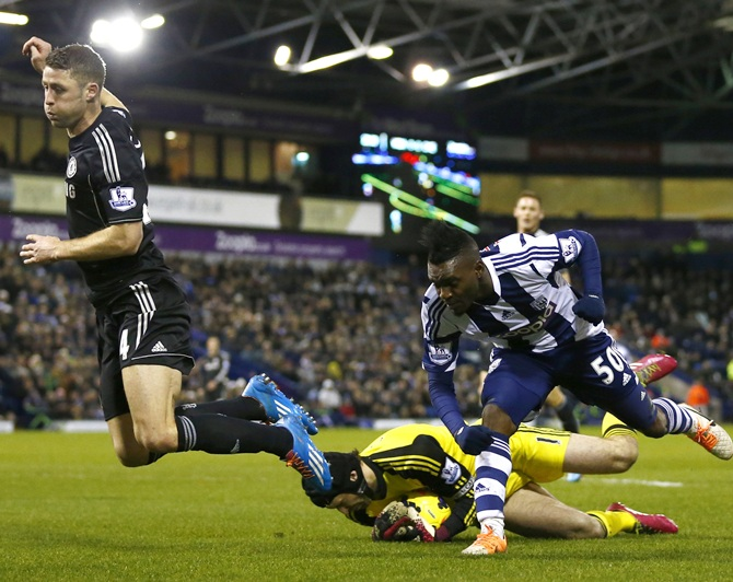 Chelsea's Gary Cahill,left, and Petr Cech, centre, challenge West Bromwich Albion's Thievy Bifouma.