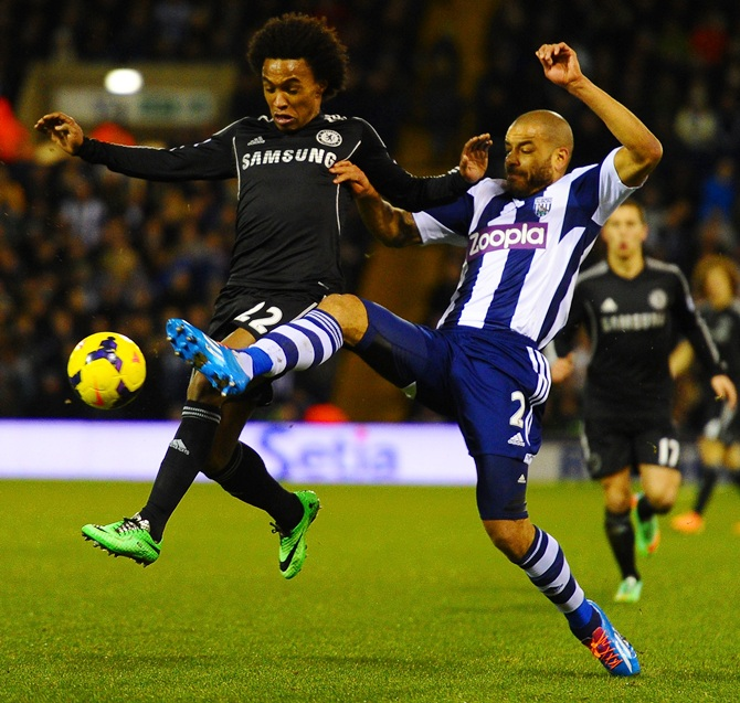 Willian of Chelsea is tackled Steven Reid of West Brom.