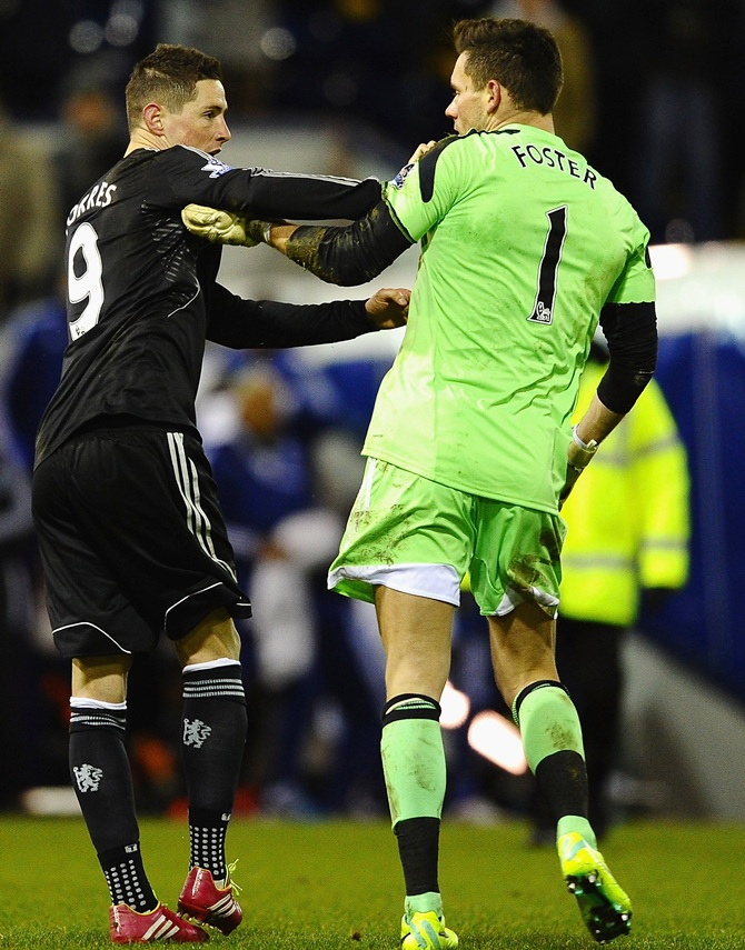 Fernando Torres of Chelsea clashes with Ben Foster of West Brom.