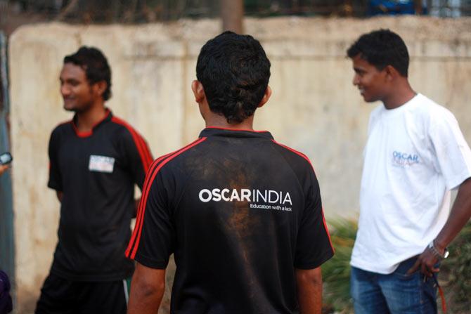 Ashok Rathod looks on proudly.