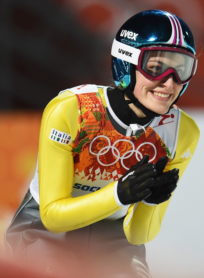 Evelyn Insam of Italy smiles during the Ladies' Normal Hill Individual.