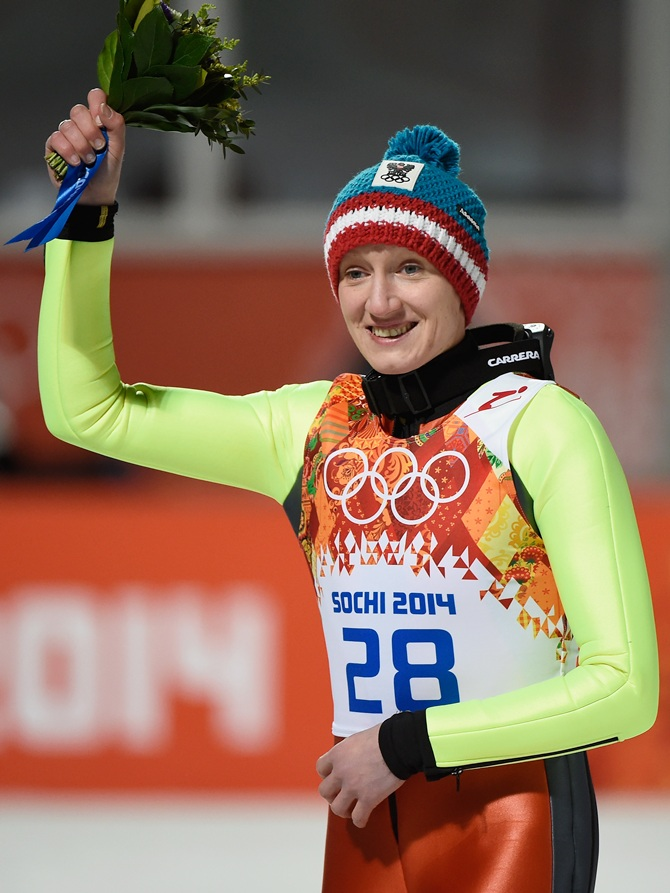 Daniela Iraschko-Stolz of Austria celebrates after the flower ceremony.