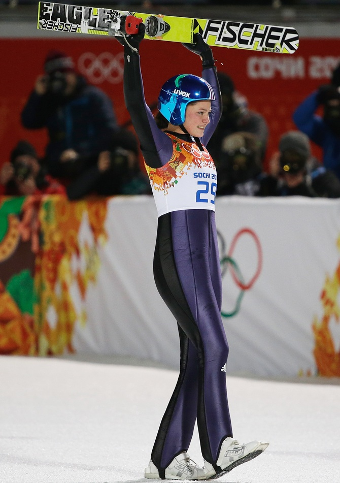 Carina Vogt of Germany celebrates winning the gold medal during the Ladies' Normal Hill Individual final.