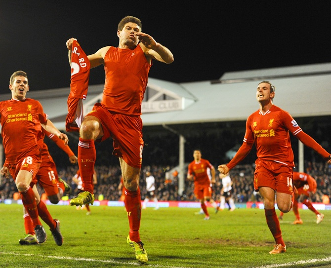 Steven Gerrard of Liverpool celebrates scoring their third goal f