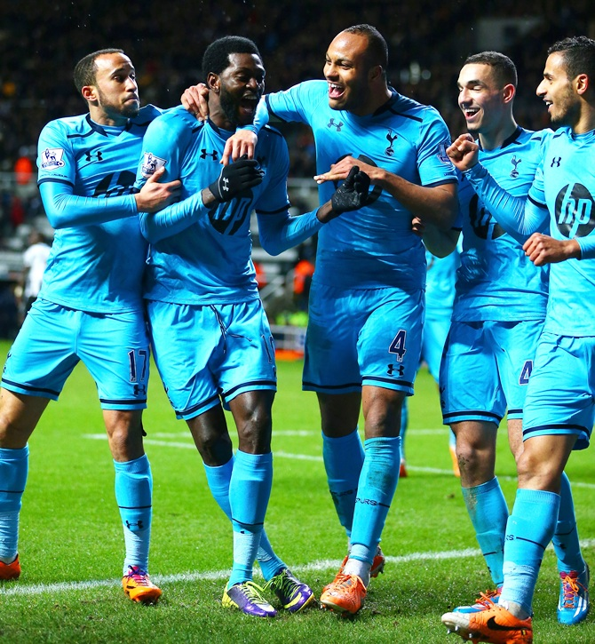 Emmanuel Adebayor of Tottenham Hotspur, second right, celebrates scoring their third goal with teammates.