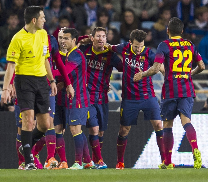 Lionel Messi,centre, of FC Barcelona celebrates after scoring.